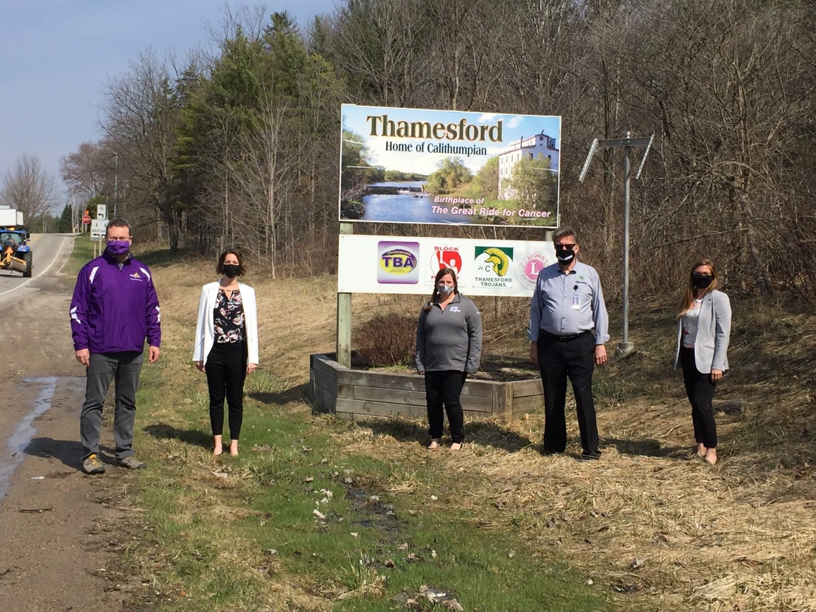 Members from Quadro and Township of Zorra in front of the Town Sign for Thamesford, Ontario for Connecting the Community of Thamesford announcement